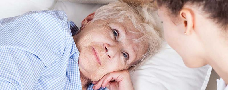 elderly woman in bed